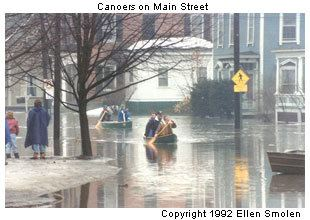 Canoers on Main Street during flooding
