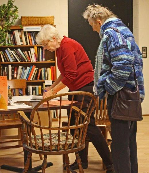 Two members of the Montpelier Senior Activity Center reviewing notes